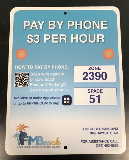 New pay by phone signs with new logo being put up around Town by the Public Works Department