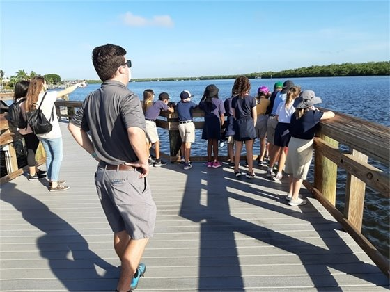Students visiting Mound House watched a dolphin playing in the back bay