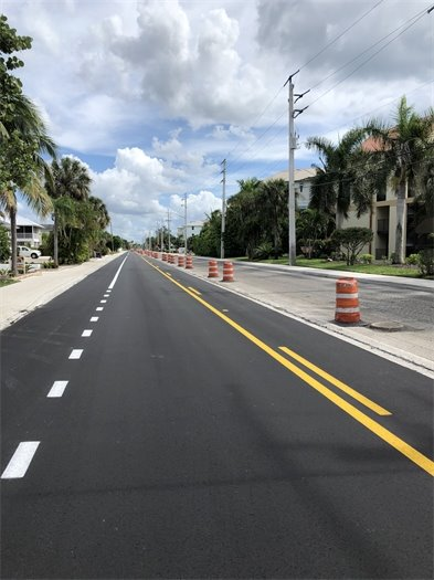 View of Estero Boulevard south of Publix with one lane fresh paved and the other lane prepped for paving