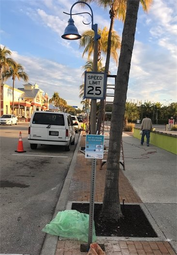 Parking signs with new Town logo are replacing the old signs