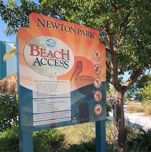 Beach access sign at Newton Beach Park orange with pelican